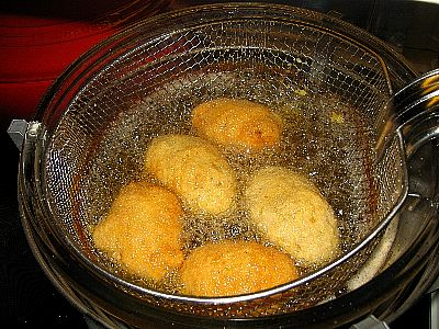 Arancini being fried